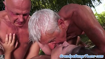 Teen enjoying outdoor threesome with seniors