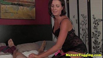 Classy milf stroking cock sensually