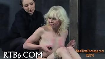 Slaver is torturing babe's vagina