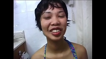 Young Filipina girl sucks BBC on the toilet