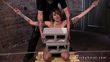 Ankle binders bondage Brunette caned and gagged in ankle suspension