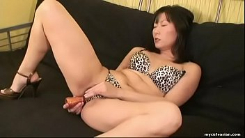 Brunette Asian slut rubbing her wet pussy with a toy