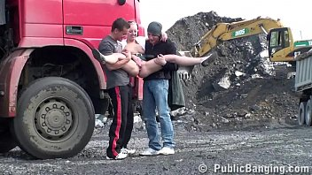 A very cute blonde young lady is fucked in public threesome at a construction site