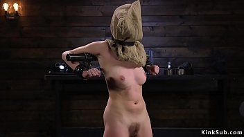 Slave with bag on a head in device bondage