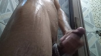 skinny young boy jerking during bath
