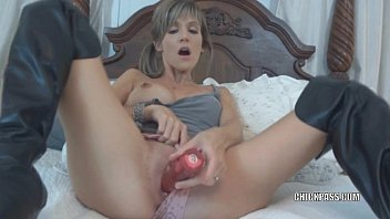 Blonde wife Jolene in black boots while fucking her toys and sucking some dick thumbnail