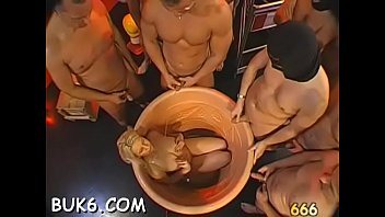 Busty darling gets pussy and face pissing from 2 males
