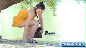 Horny brunette amateur teen Kylie finger fuck her juicy pussy outside by the lake