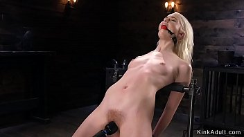 Blonde slave whipped and gagged with toy