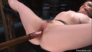 Strapped blonde is fucked with dildo