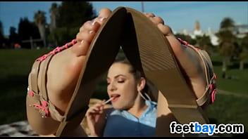 Wearing Sandals On Her Beautiful Feet Outside