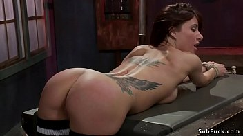 Bent over busty babe ass caned in bondage