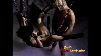 Stunning raven-haired slag gets nailed while being suspended from the ceiling