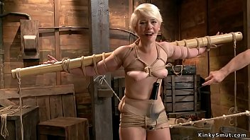 Blonde slave in strict rope bondage