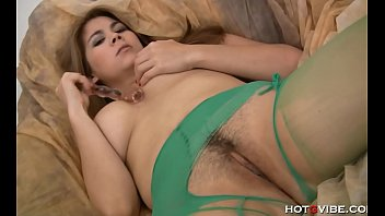 Plump brunette with enormous tits pleasures herself
