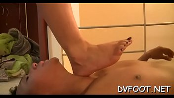 Girl shows off sexy feet and massages knob with them