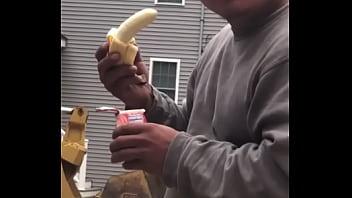 Straight construction man sucks banana