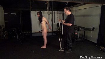 Rope bondage and sexy restrained kinky brunette struggling in hard tied dungeon