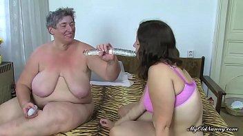 Fat nanny and curvy girl share dildo