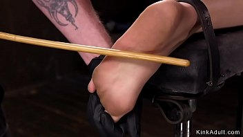 Slave in device bondage gets caned