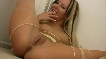 Blonde snatches off her stockings and masturbates and licks all her pleasure