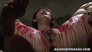 Asian babe get her privates covered in wax.