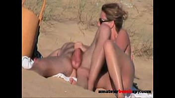 Amateurbeachspy.com - Nudist wife giving blowjob on beach