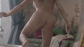 Leelee Sobieski shows a brief view of her cunt from behind and has a mild lesbian sex scene with Tara Fitzgerald from the mainstream movie In A Dark Place