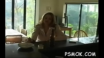 Horny doxy smokin' a cigarette and touching herself