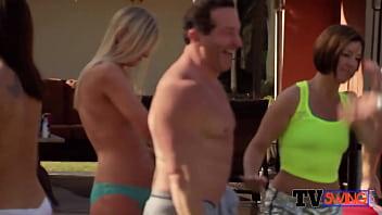 Swinger couples get naked slowly.