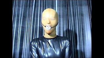 Lovely girl in latex mask posing