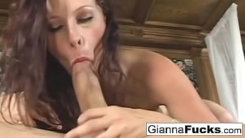 Brunette pornstar Gianna Michaels gets fucked on the bed