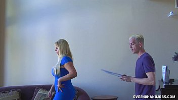 Huge-Titted Blonde Strokes A Young Guy's Cock preview image