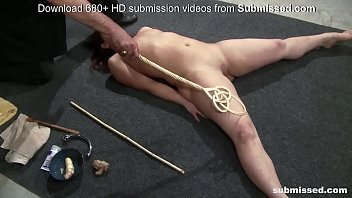 Submissive slave gets anal wooden buttplug and spanked hard