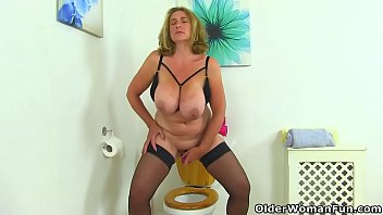 Big titted milf Camilla from the UK gets naughty on toilet