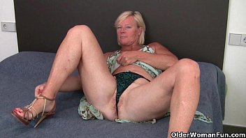 Old grandmother pussy Grandma pushes a dildo up her ass and pussy