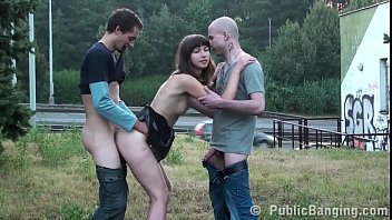 A cute chick is fucked hard in PUBLIC threesome sex