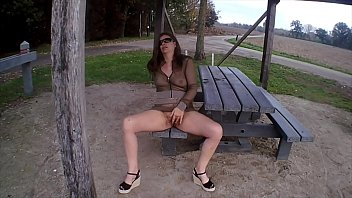 Flashing, masturbating and pissing in a public place in fishnet outfit