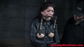 Restrained slave riding sybian while gagged