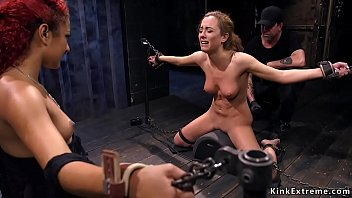Blonde slave double caned in dungeon