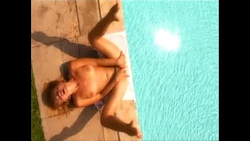 Sexy girl masturbates by the pool