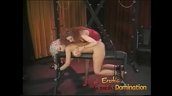 Busty dominatrix surrenders herself to a friend in a bdsm session