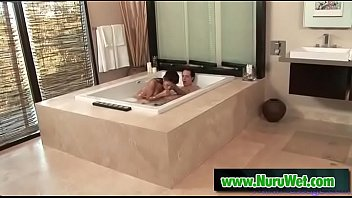 Busty Jackie Lin gives a nuru massage with her perfect body