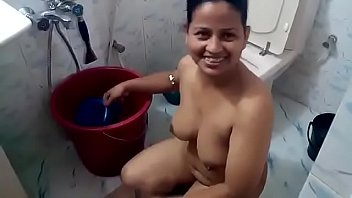 Curvy Bangla woman washing her hair and body