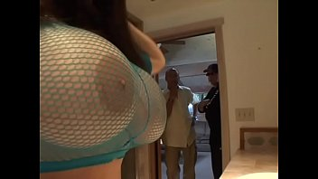 Sexy brunette in pink fishnet Daphne Rosen loves to take hard dick in mouth  and between her amazing boobs