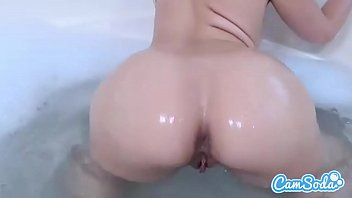Anikka Albrite big ass blonde masturbating with dildo in tub.