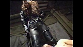 Norris gettting his ass kicked - Asian femdom full leather pants and jacket trampling ball kicking with long fetish boots