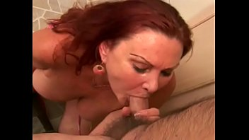 Cunning  mature lady Sierra Vista with red hair and big boobs needs to put the bite on her bald neighbour
