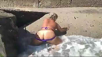 BBW lady on beach play with naked boobs