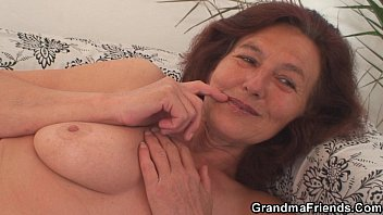 Skinny granny swallows two cocks
